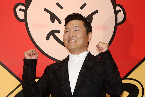 Psy's singles shoot to the top of the charts